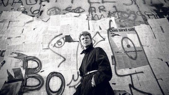 """In 1987, Bowie returned to the divided city to perform for a crowd of 70,000 fans, their sparklers and candles glittering around the Reichstag. Towards the end of the show he read aloud a message in German. ""We send our best wishes to all our friends who are on the other side of the Wall."" Then he sang ""Time will Crawl"". On the other side of the hateful divide, hundreds of young East Berliners strained to hear echoes of the concert. They caught sight of stage lights flashing off blank, bullet-marked walls. They heard Bowie greet them. They listened to his song. Their song. Berlin's song. ""We can be heroes, just for one day,"" he sang in a daring, ironic elegy to both the divided world and his past life.  As ""Time will Crawl"" reached its climax some of the East German crowd pushed towards the Brandenburg Gate, whistling and chanting, ""Down with the Wall"". They threw insults and bottles at the Volkspolizei, rising together in a rare moment of protest. On stage Bowie heard the cheers from the other side. He was in tears."" Read full article: The Berlin landmarks that inspired David Bowie  http://www.ft.com/cms/s/2/b20113b0-8753-11e3-9c5c-00144feab7de.html#axzz2s3ZrCQb6"